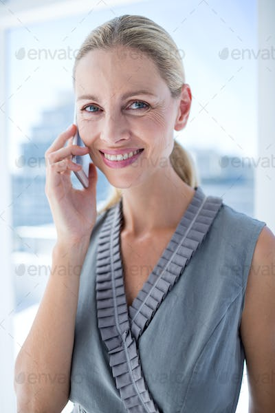 Portrait of a smiling businesswoman on the phone
