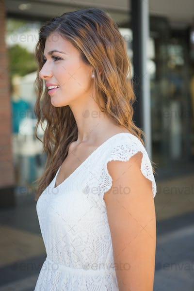 Smiling attractive woman at the shopping mall