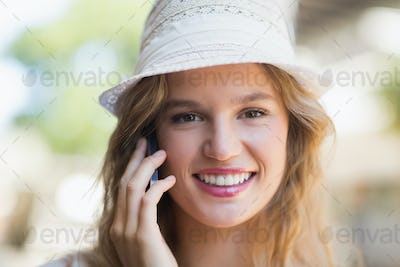 Portrait of a pretty smiling woman on the phone