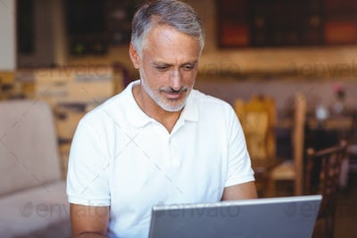 Happy man using his laptop computer