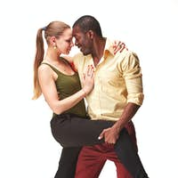 Young couple dances Caribbean Salsa, studio shot
