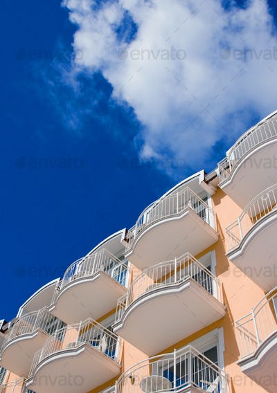 Orange Hotel in front of a blue sky