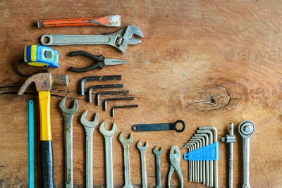 Set of work tools on old grunge wood background
