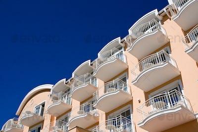 Orange facade with blue sky