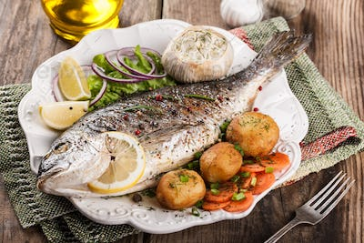 Baked fish dorado with vegetables