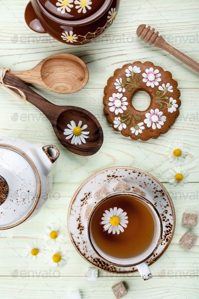 Chamomile tea with decoration gingerbread cookie