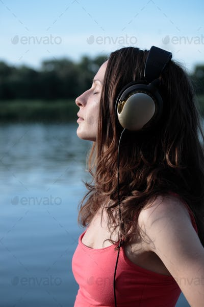 Cute woman listening to music