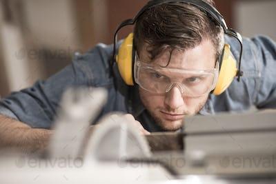 Carpenter using protective headphones