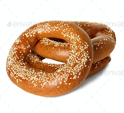 Bagels with sesame seeds isolated on white background