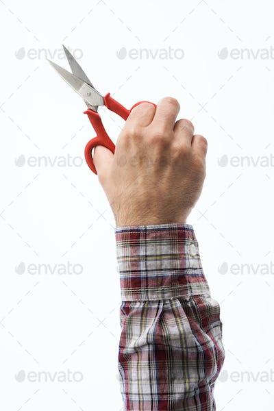 Hands holding electrician's scissors