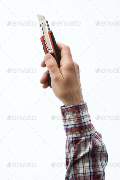 Hand holding a cutter