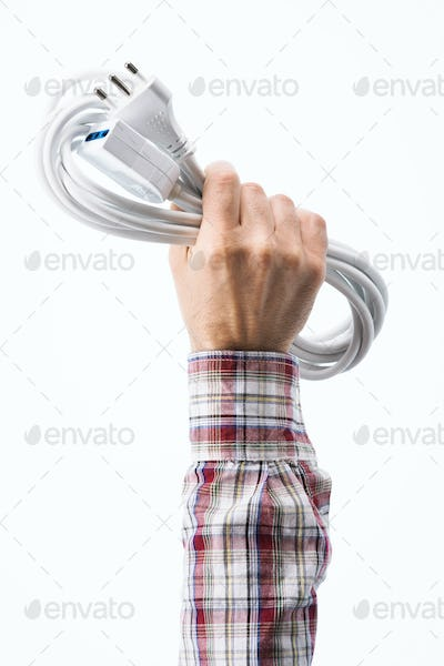Hand holding a power cable