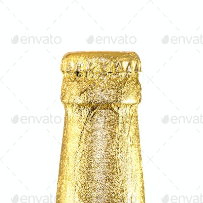 Neck closed beer bottles wrapped in gold foil