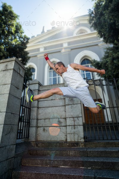 Extreme athlete jumping in front of building in the city