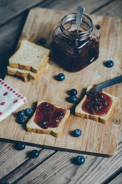 Toast bread with wild strawberry jam. Retro,vintage filter