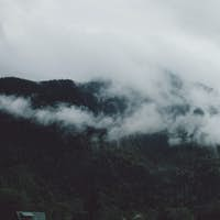 misty mountains with lush green hills