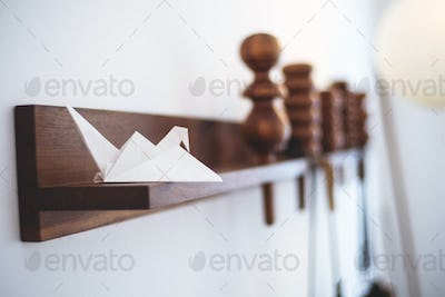 Origami on wooden shelf