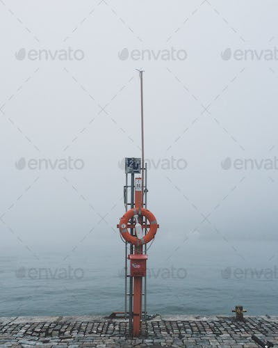 Sea view on a foggy day with sailing accessories