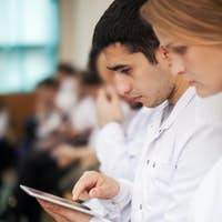 Medical students with modern devices on the lecture