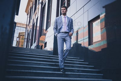 Businessman walking on the stairs outdoors