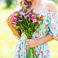 beautiful girl with a bouquet of flowers