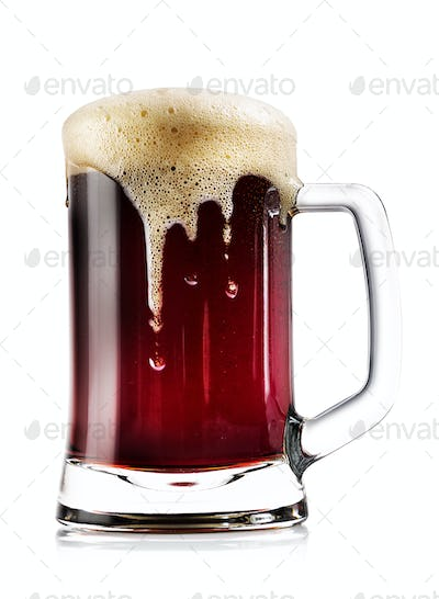 Mug thick dark beer with foam