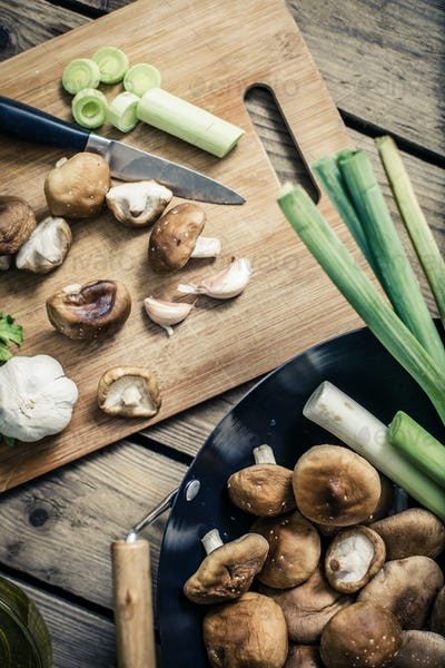shitake mushroom prepare for cooking on wok and chopping block