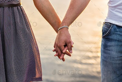 Happy couple holding hands