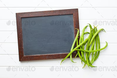 blank chalkboard and green beans