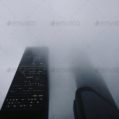 Two giant skyscrapers looking as if they are fighting each other