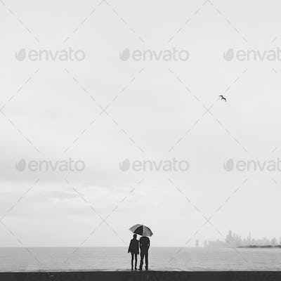 Lovers with Umbrella at the Lake front