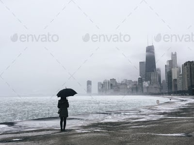A Girl With an Umbrella Look at Chicago Skyline
