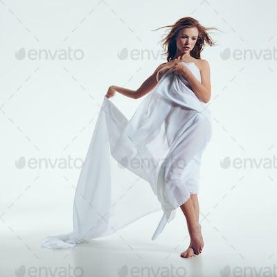 Female model in transparent white cloth
