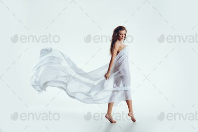 Sensual brunette nude woman covered with scarf