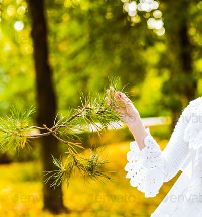 girl touching tree
