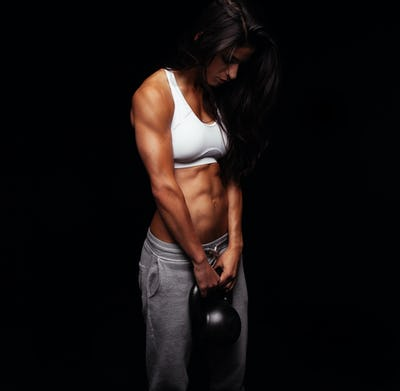 Young woman doing crossfit workout