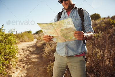 Man in countryside with a map