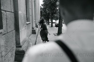 European beautiful couple posing on the street