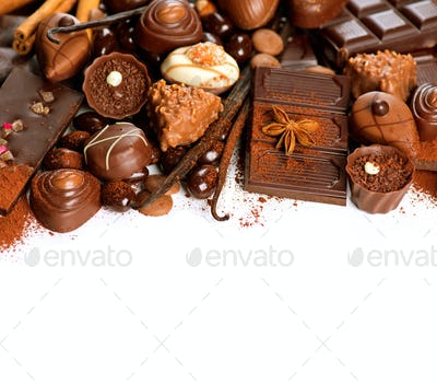 Chocolate border over white. Variety of praline sweets