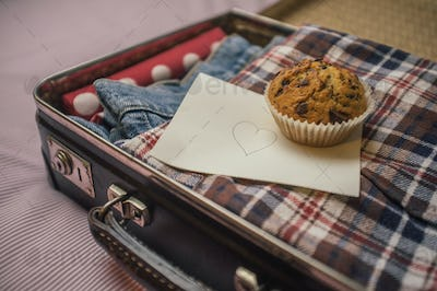Suticase, muffin and a love letter