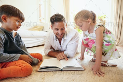 Father reading stories to his children