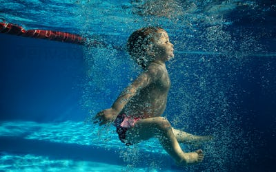 Child swimming underwater