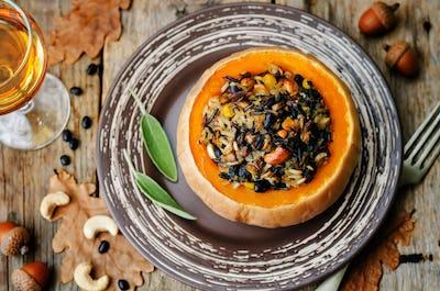 pumpkin stuffed with rice, black beans, corn, cashews and mushro