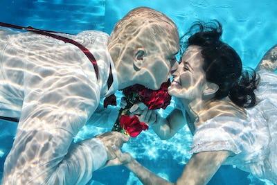underwater bride and groom