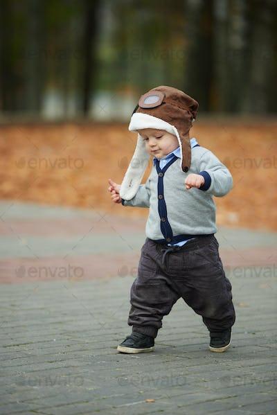 little boy in helmet pilot portrait