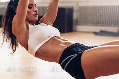Fit young woman exercising at gym