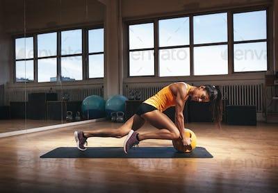 Muscular woman doing intense core workout