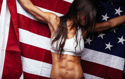 Female athlete holding American Flag