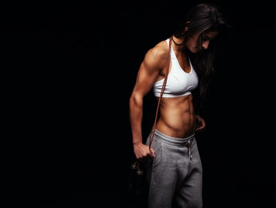 Fitness young woman with a jump rope