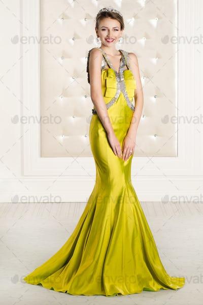 Beautiful woman in a yellow long dress